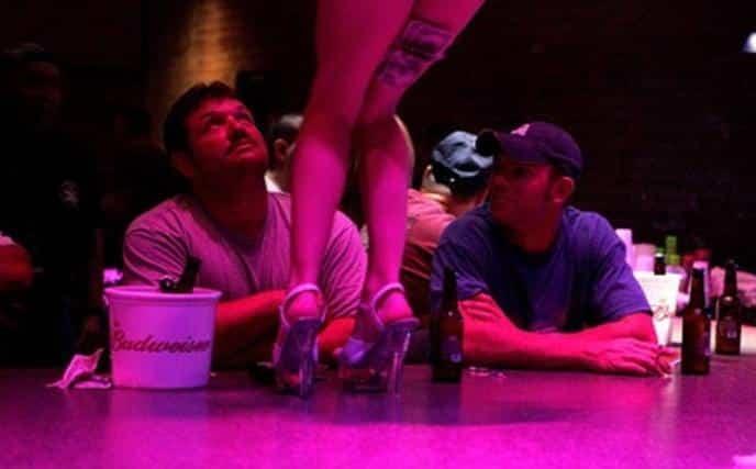 Strip Club Patrons & Stripper's legs (Getty)